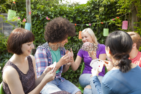 group of young adult friends playing