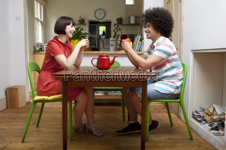 young couple sitting at kitchen table