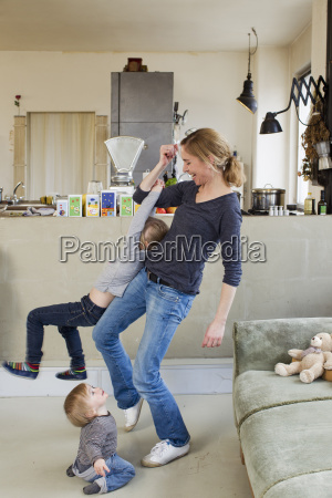 mid adult mother playing with her