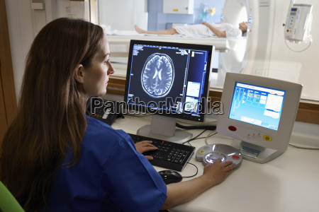 radiologist looking at brain scan image