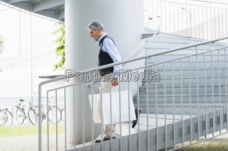 senior adult businessman walking with shopping