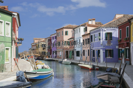 pastel colored houses and boats on