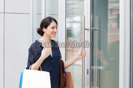 young businesswoman carrying shopping bags