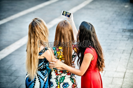 rear view of three young women