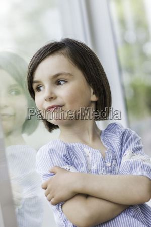 young girl looking out of window