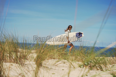 woman with surfboard on beach lacanau