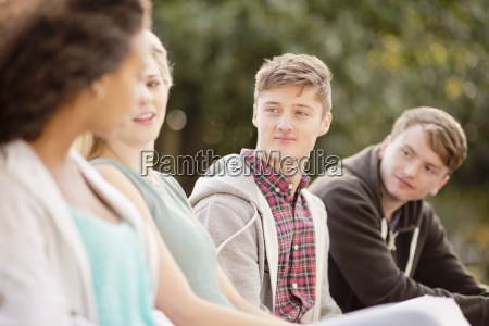 four young adult friends chatting in