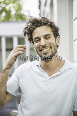candid portrait of young man outside