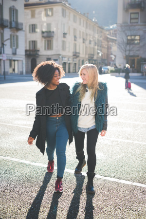 two female friends chatting and strolling