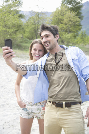 young couple taking self portrait on