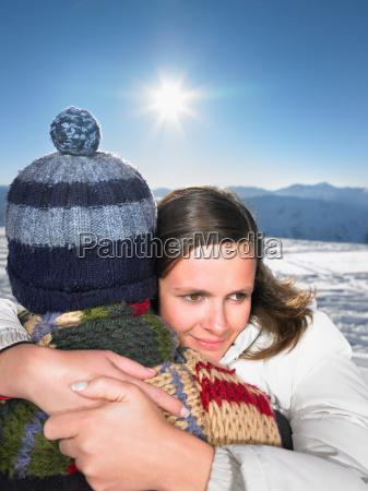 couple hugging on mountain top
