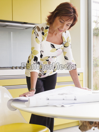 senior woman looking at plans