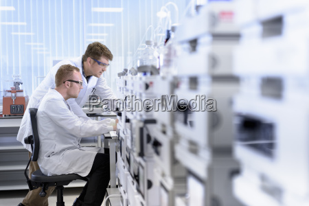 scientists testing samples in laboratory