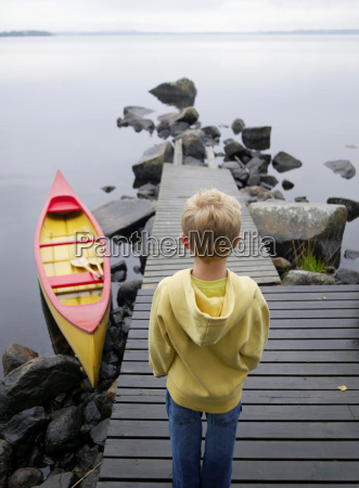 young boy on a dock near