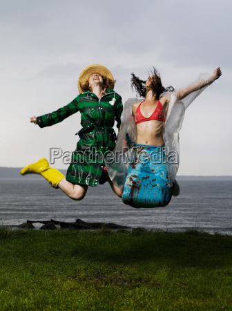 two women jumping together