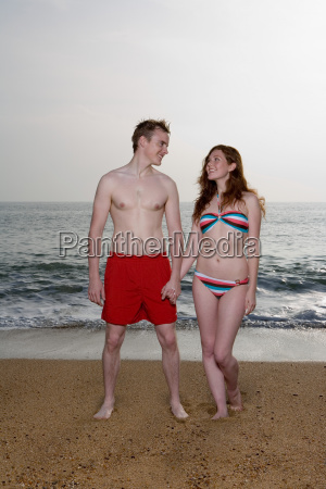 young couple in swimming wear