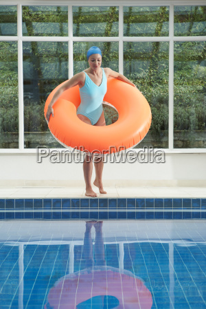 woman standing with rubber ring by