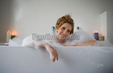 woman smiling in bathtub