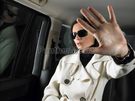 woman in car sunglasses on