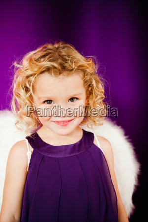 young girl in angel costume
