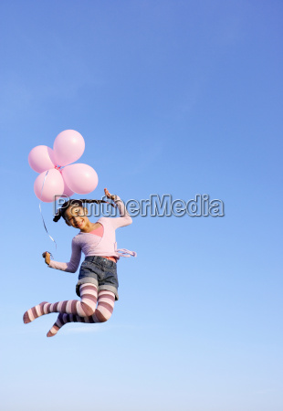 girl jumping in the air with