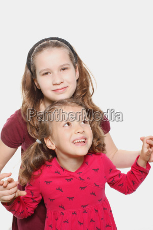 young girl playing with sister