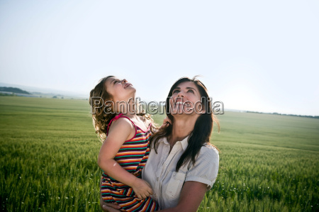 woman and child looking at sky