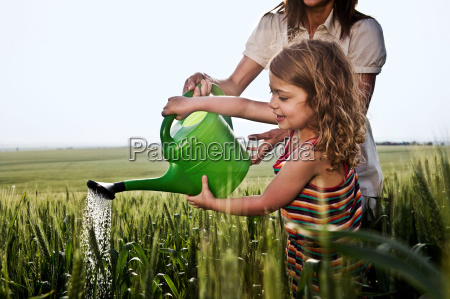 woman and child with watering can