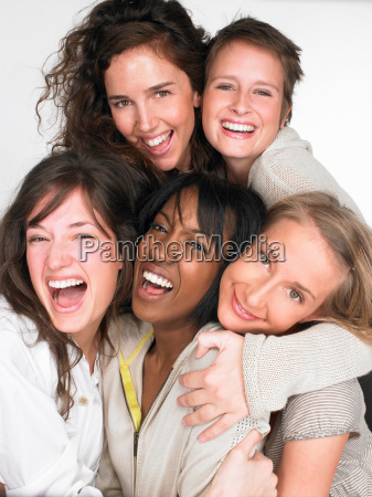 women smiling and looking at the