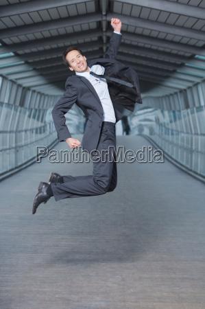 businessman jumping into air