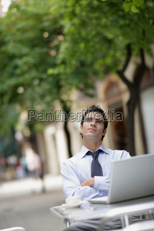 business man at cafe with laptop