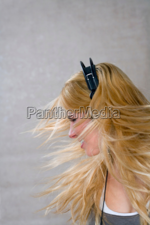 young woman moves with headphones