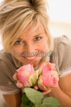 woman holding flowers in her hands