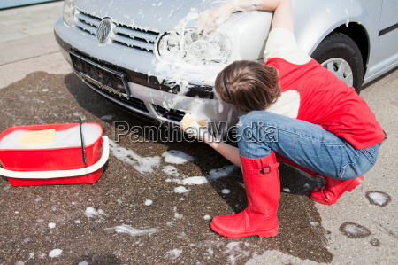 young girl washing car