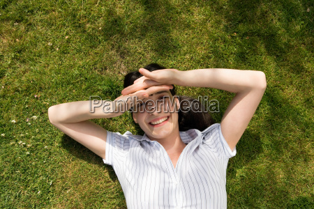 woman shielding eyes with hands