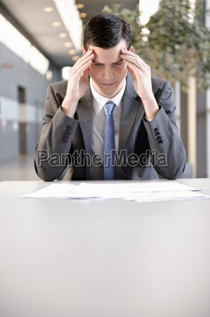 businessman holding head with hand port