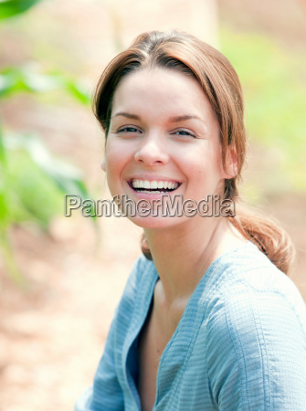 woman smiling in country scene
