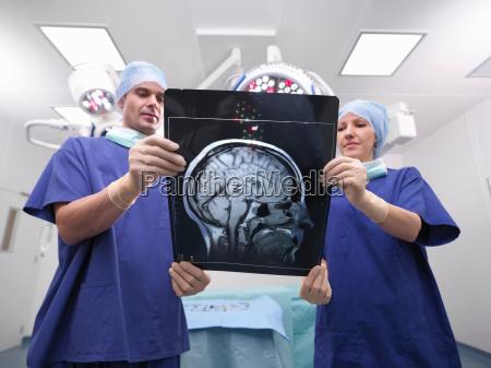nurses looking at x ray