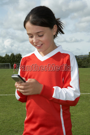 young girl on mobile phone