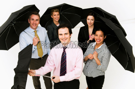 group of business people with umbrellas