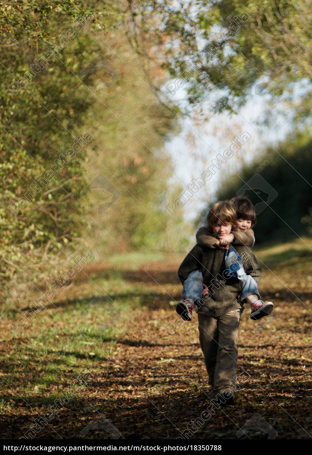 boy, carrying, young, child, in, countryside - 18350788