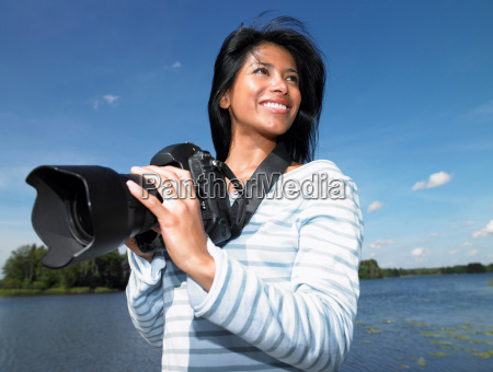 woman taking pictures smiling