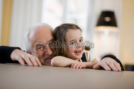 old man and young girl smiling
