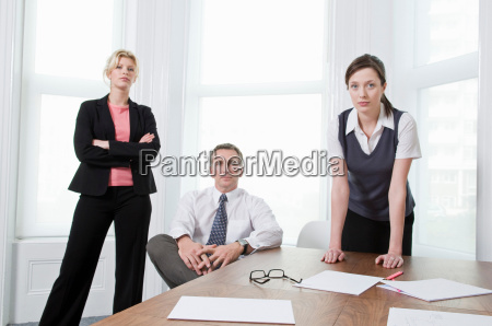 a portrait of three businesspeople