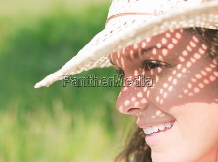 woman in sun hat in sunshine