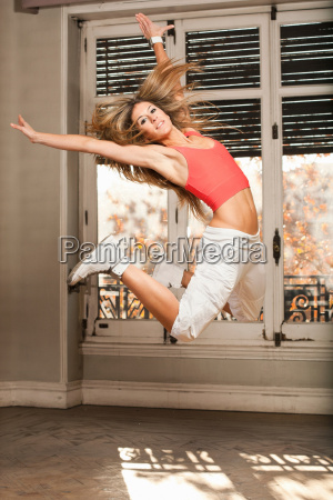 woman jumping in living room