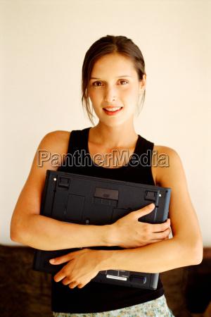 woman holding laptop