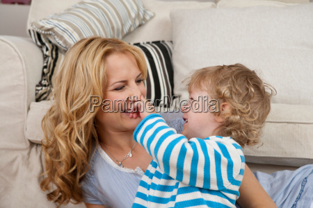 boy touching mothers nose