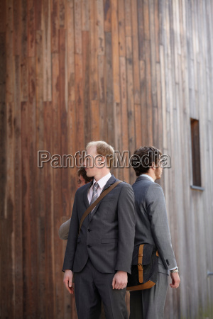 business people standing in courtyard