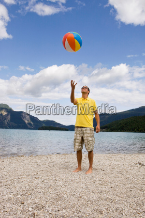 a young man throwing up a